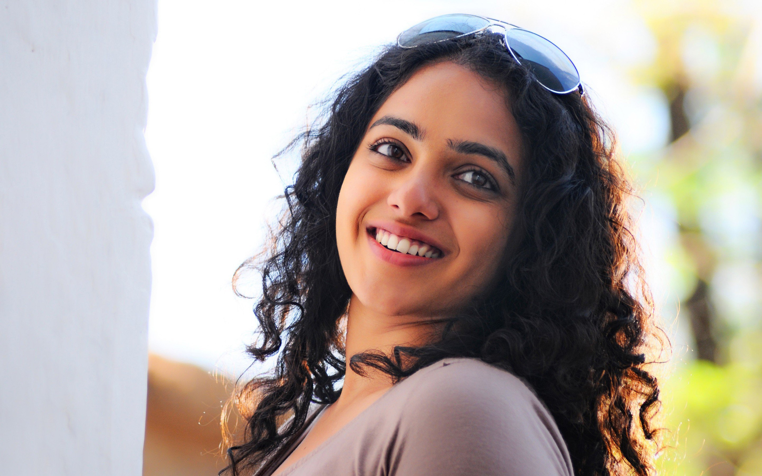 Nithya Menon Wallpapers | sucking my brother