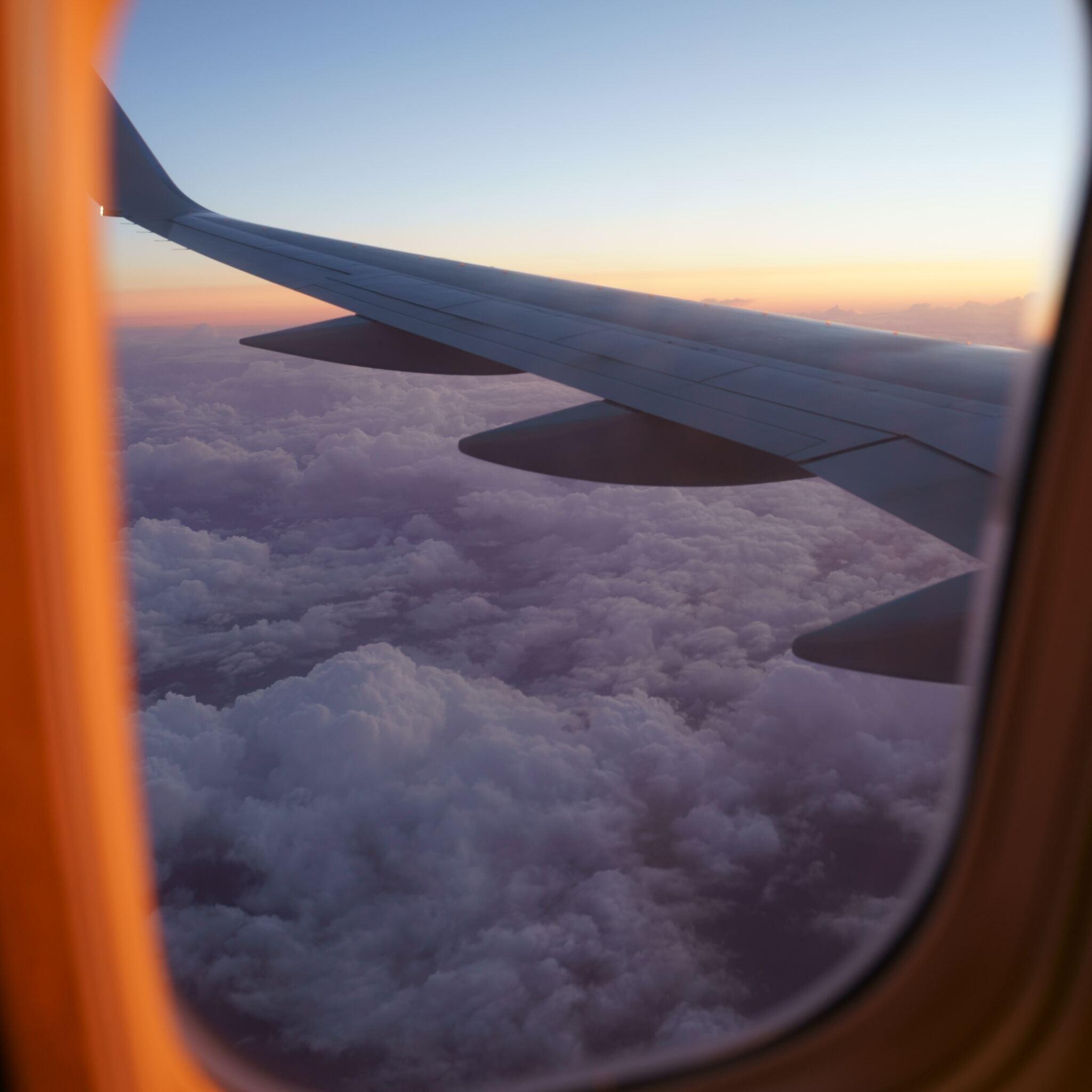 airplane-clouds-wings-flying-5k-fd.jpg