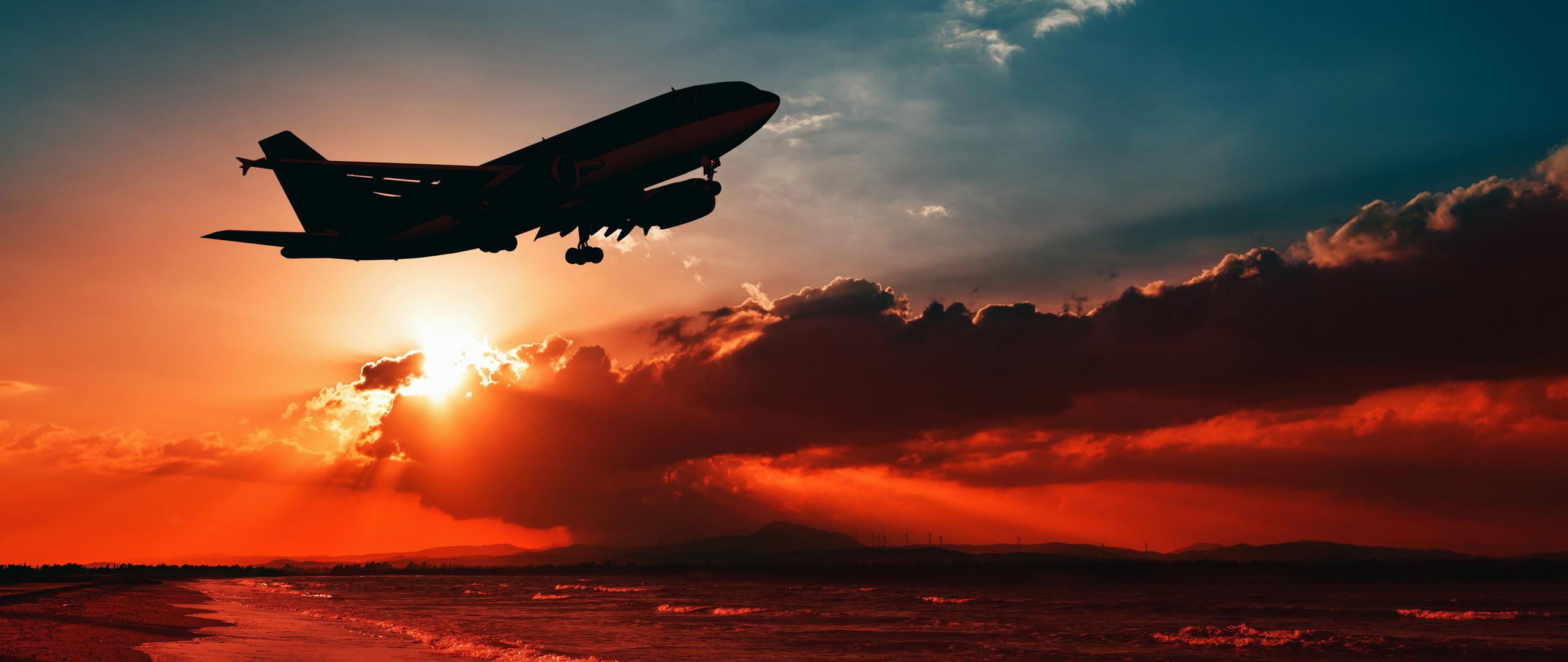 airplane-flying-over-beach-shore-sunset-5k-l9.jpg