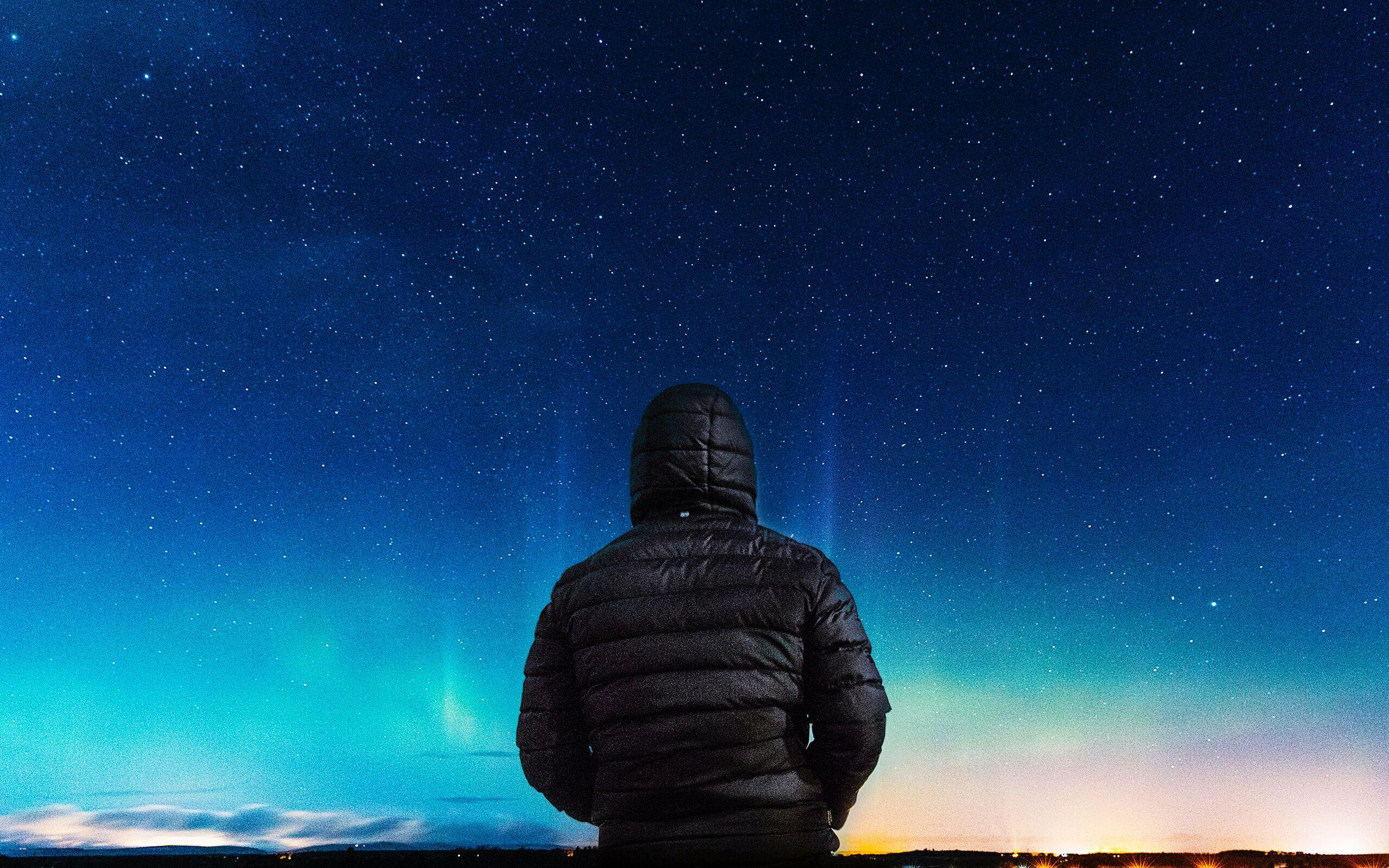 2560x1600 Alone Boy In Hoodie Looking Towards Colorful Sky