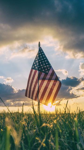 america-flag-inside-field-grass-4k-u1.jpg
