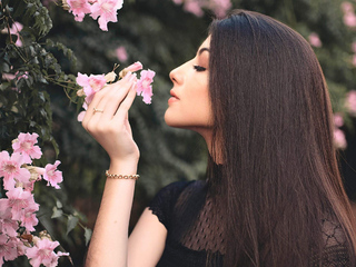 attractive beautiful girl smelling flowers 1m
