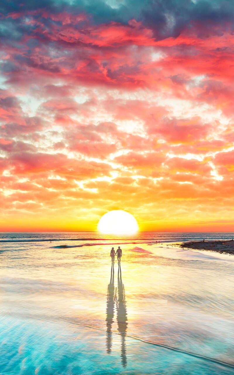 beach-couple-watching-sunset-4k-9o.jpg