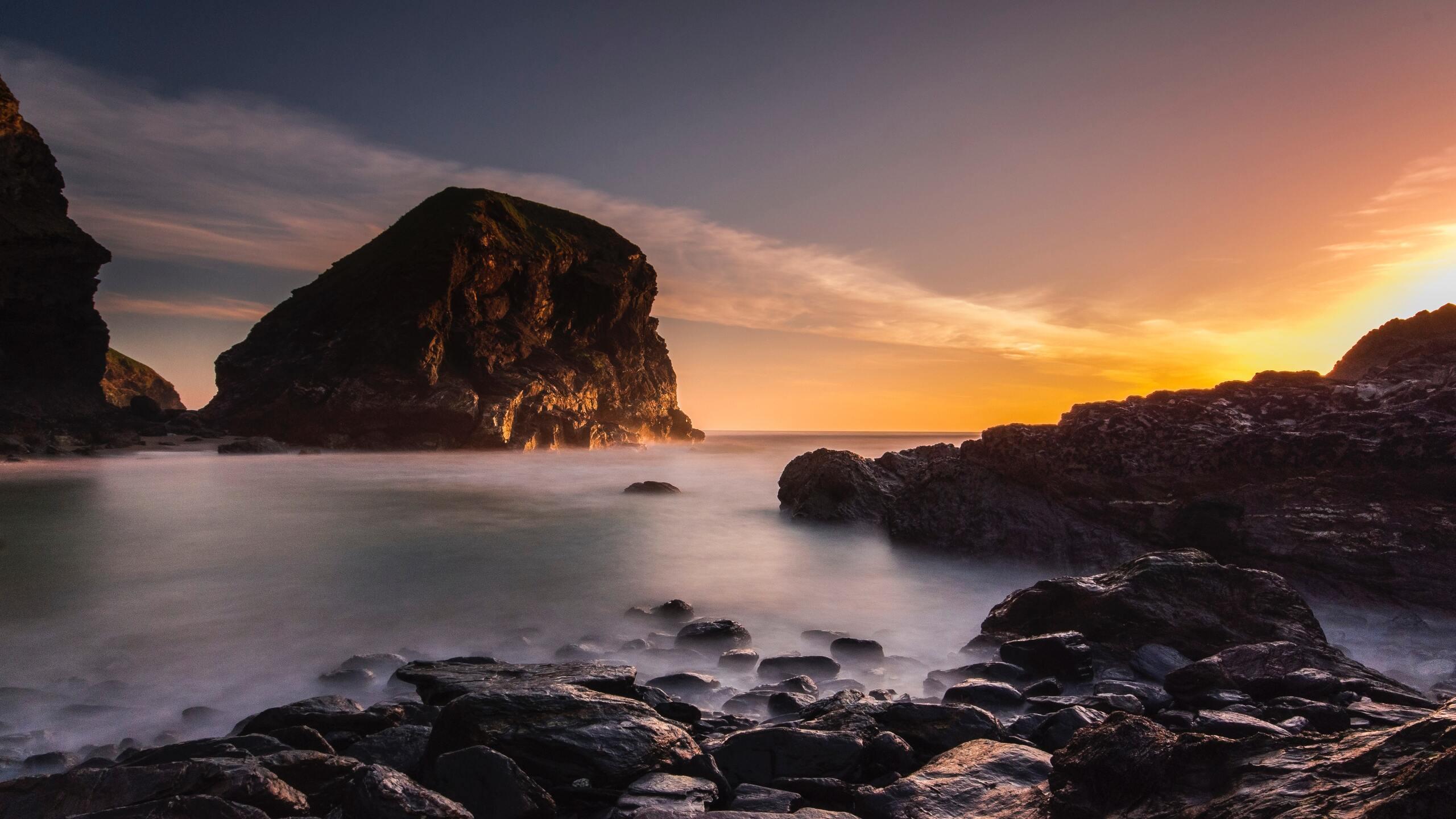2560x1440 Beach Rocks Clouds Golden Hour 5k 1440p Resolution