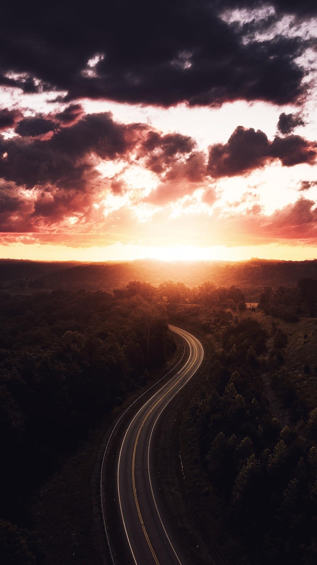 beautiful-road-path-sun-setting-drone-view-4k-x1.jpg