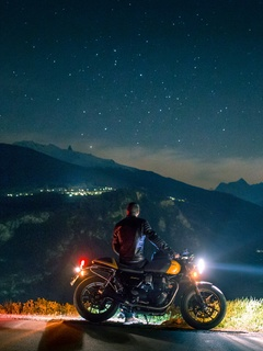 biker-rider-chilling-on-mountain-side-5k-ar.jpg