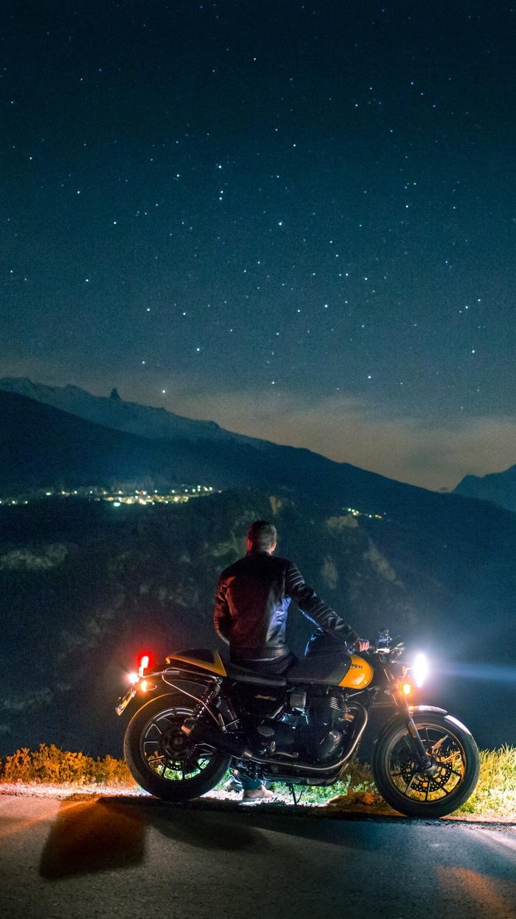 biker-rider-chilling-on-mountain-side-5k-ar.jpg