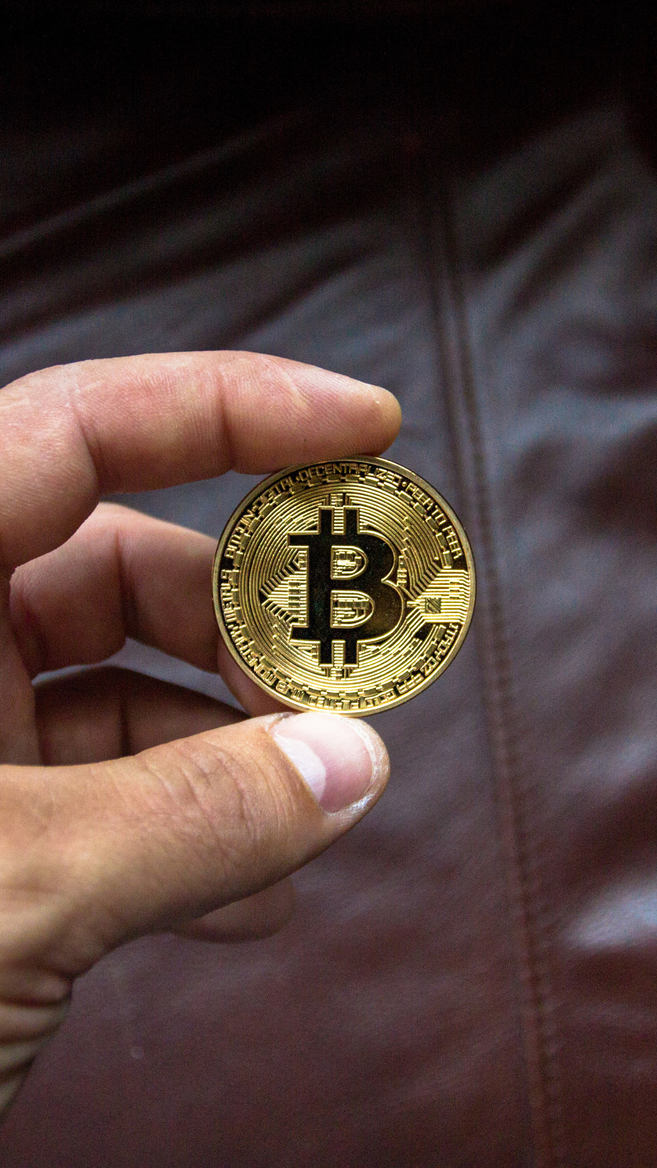 bitcoin-coin-in-person-hand-zw.jpg