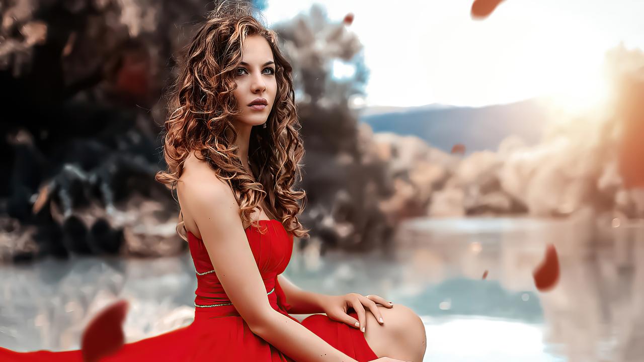 blonde-girl-red-dress-sitting-looking-at-viewer-4k-tn.jpg