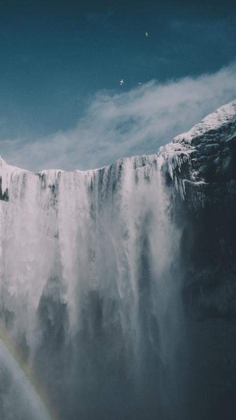 blue-sky-waterfall-snow-iceland-mountains-9x.jpg