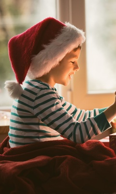 boy-opening-christmas-present-i9.jpg