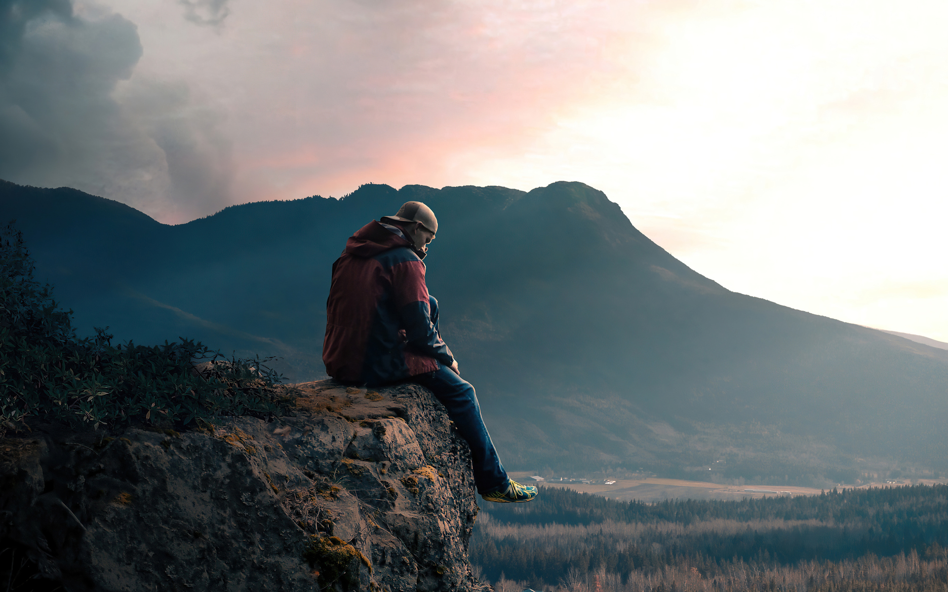 boy-sitting-alone-on-high-mountain-rock-5k-rj.jpg