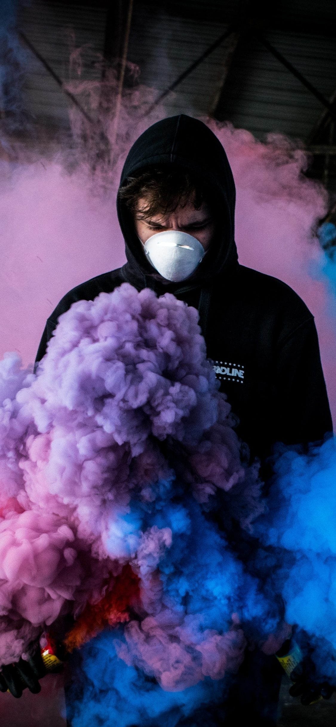 1125x2436 Boy With Smoke Bomb Colorful 5k Iphone Xs Iphone