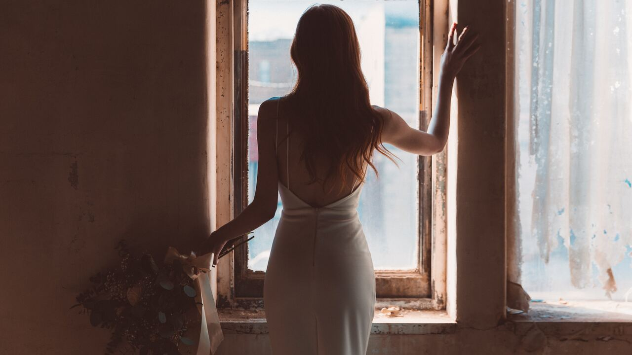 bride-standing-at-the-window-5k-oz.jpg