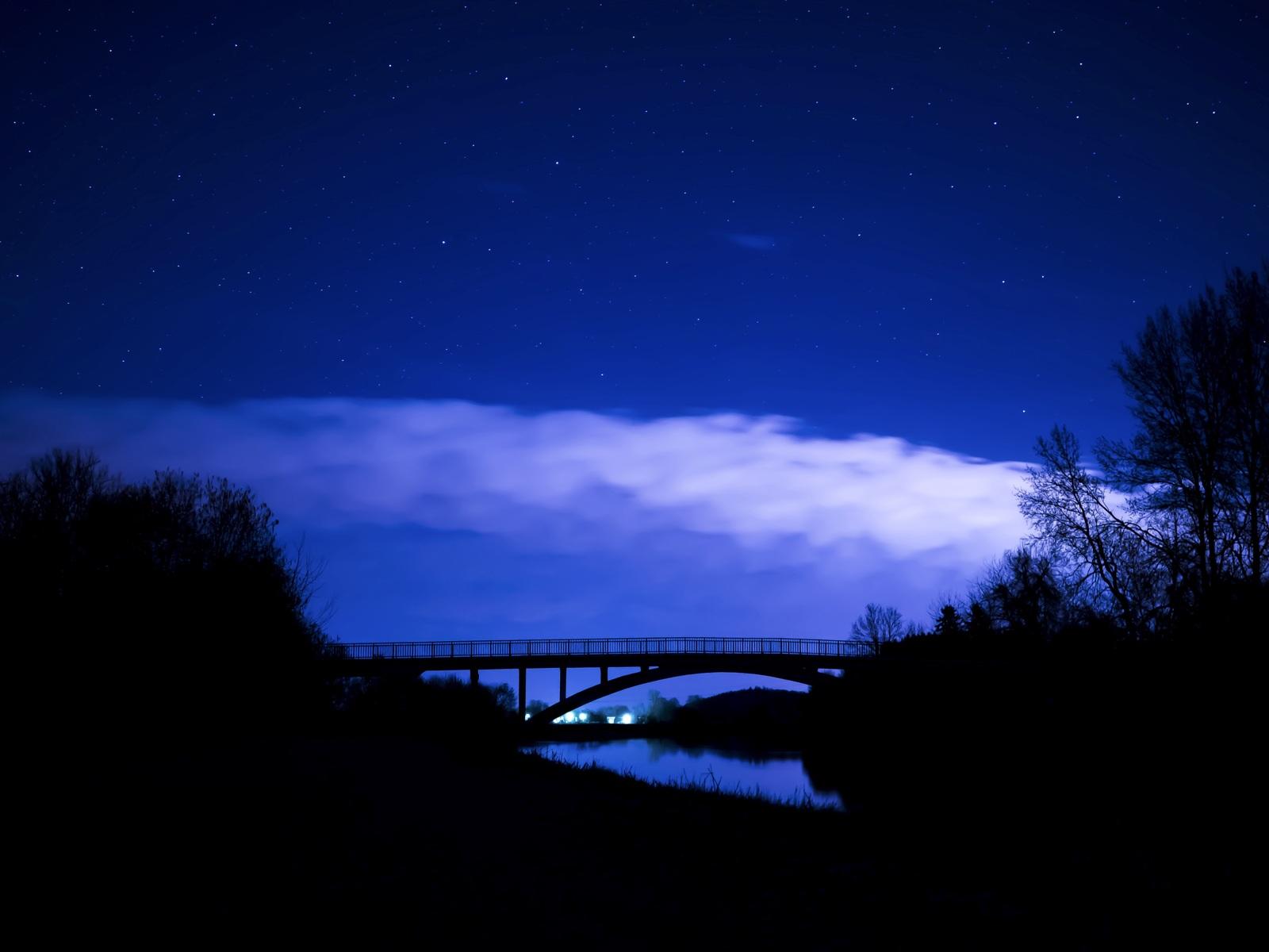 bridge-night-clouds-starry-sky-5k-go.jpg