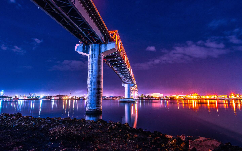 bridge-under-water-city-lights-colorful-5k-9f.jpg
