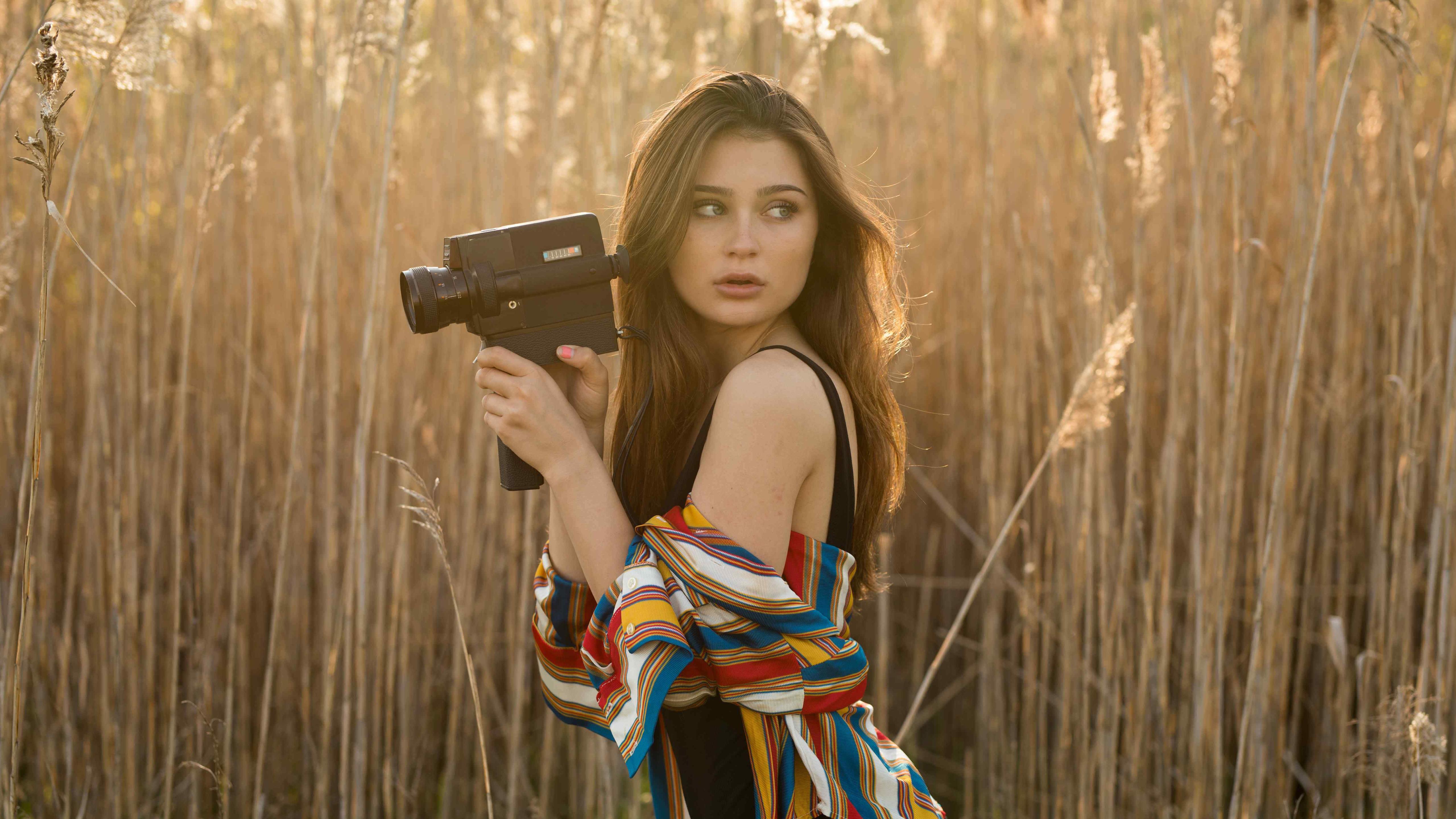 brunette-girl-in-field-with-camera-12.jpg