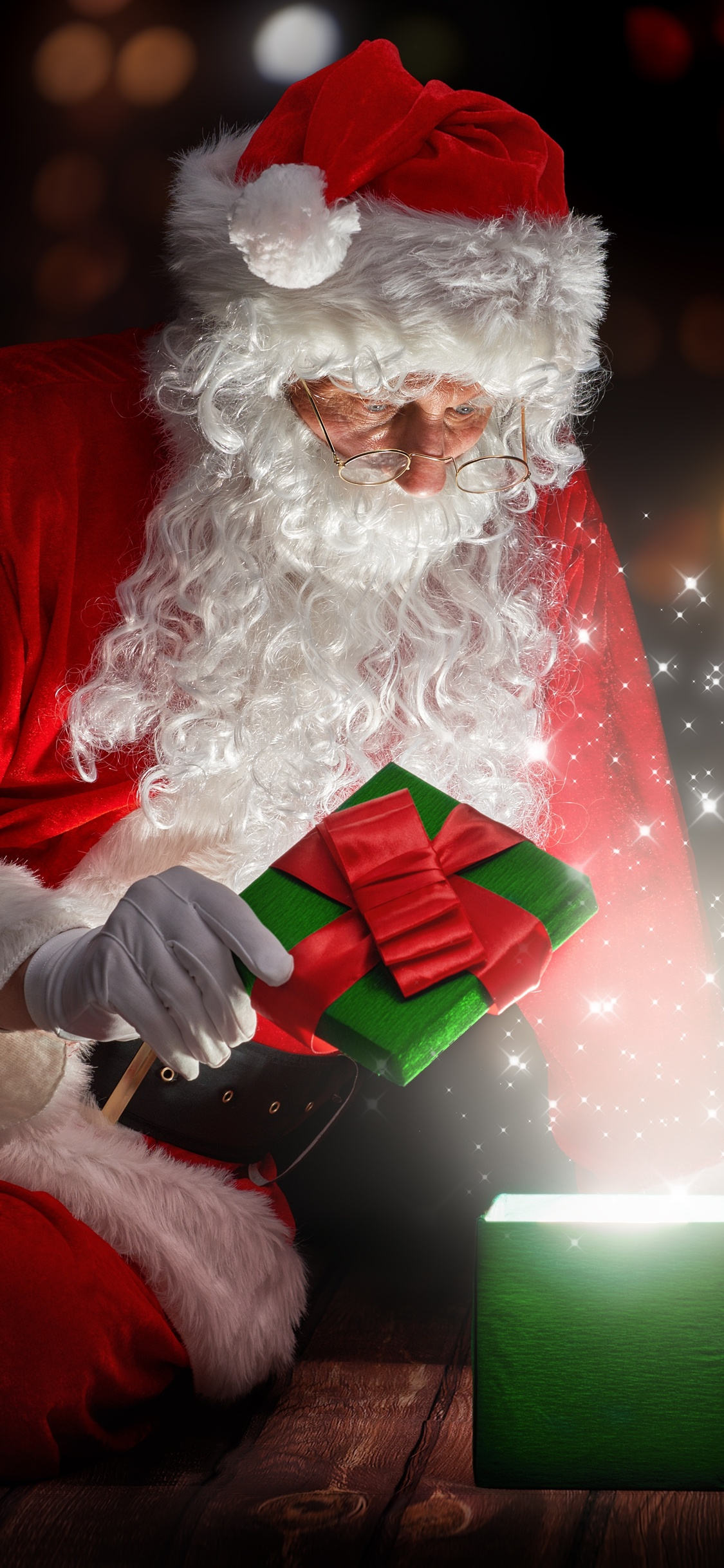 1125x2436 Christmas Santa Claus Opening Gifts Iphone Xs