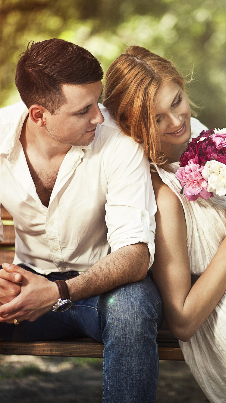 couple-sitting-on-bench-with-flowers-oz.jpg