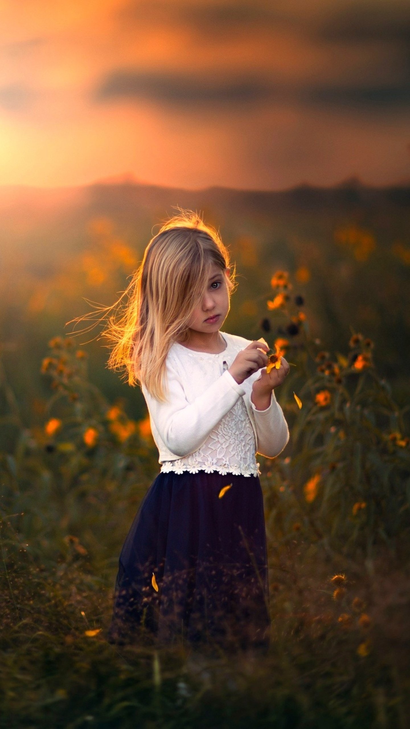 cute-child-girl-with-flowers-outdoors-k5.jpg