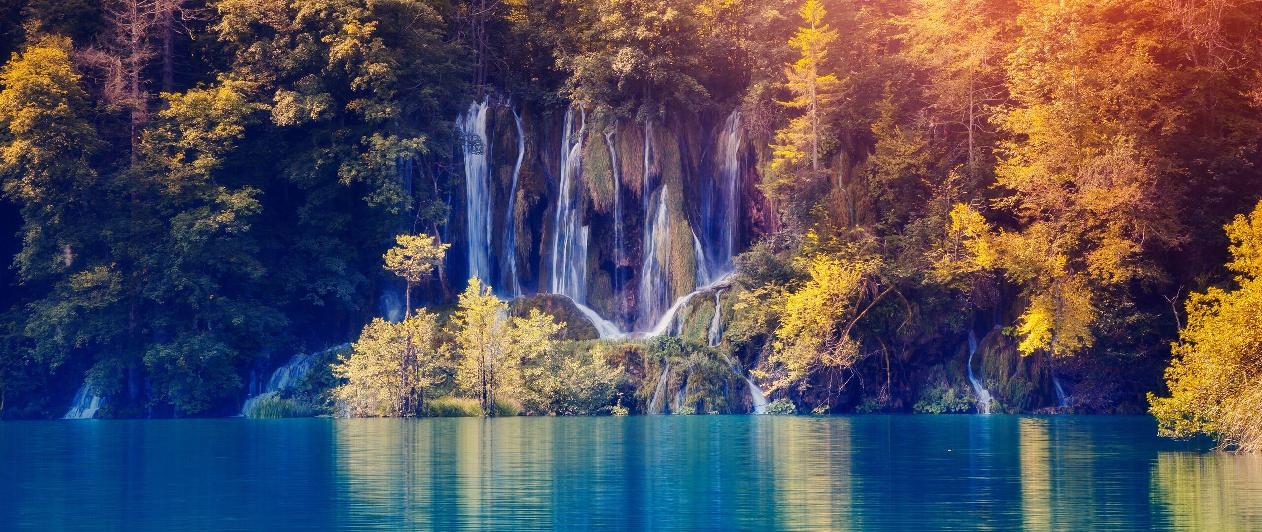 fall-foliage-lake-nature-waterfall-lu.jpg