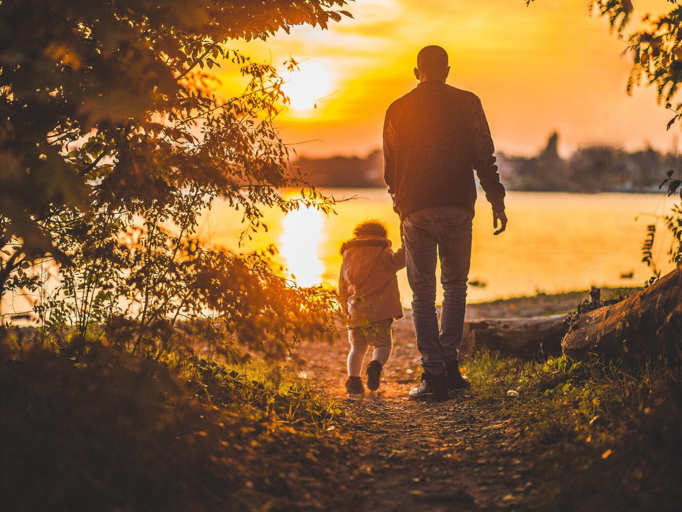 father-and-kid-walking-towards-lake-3o.jpg