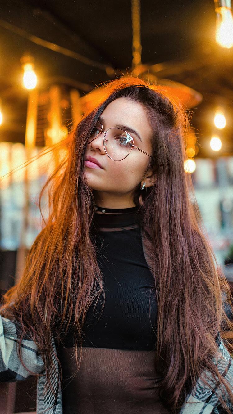 girl-glasses-playing-with-hair-restaurant-lights-4k-ji.jpg