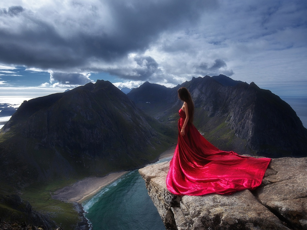 girl-in-red-dress-standing-on-the-edge-of-mountain-cliff-4h.jpg