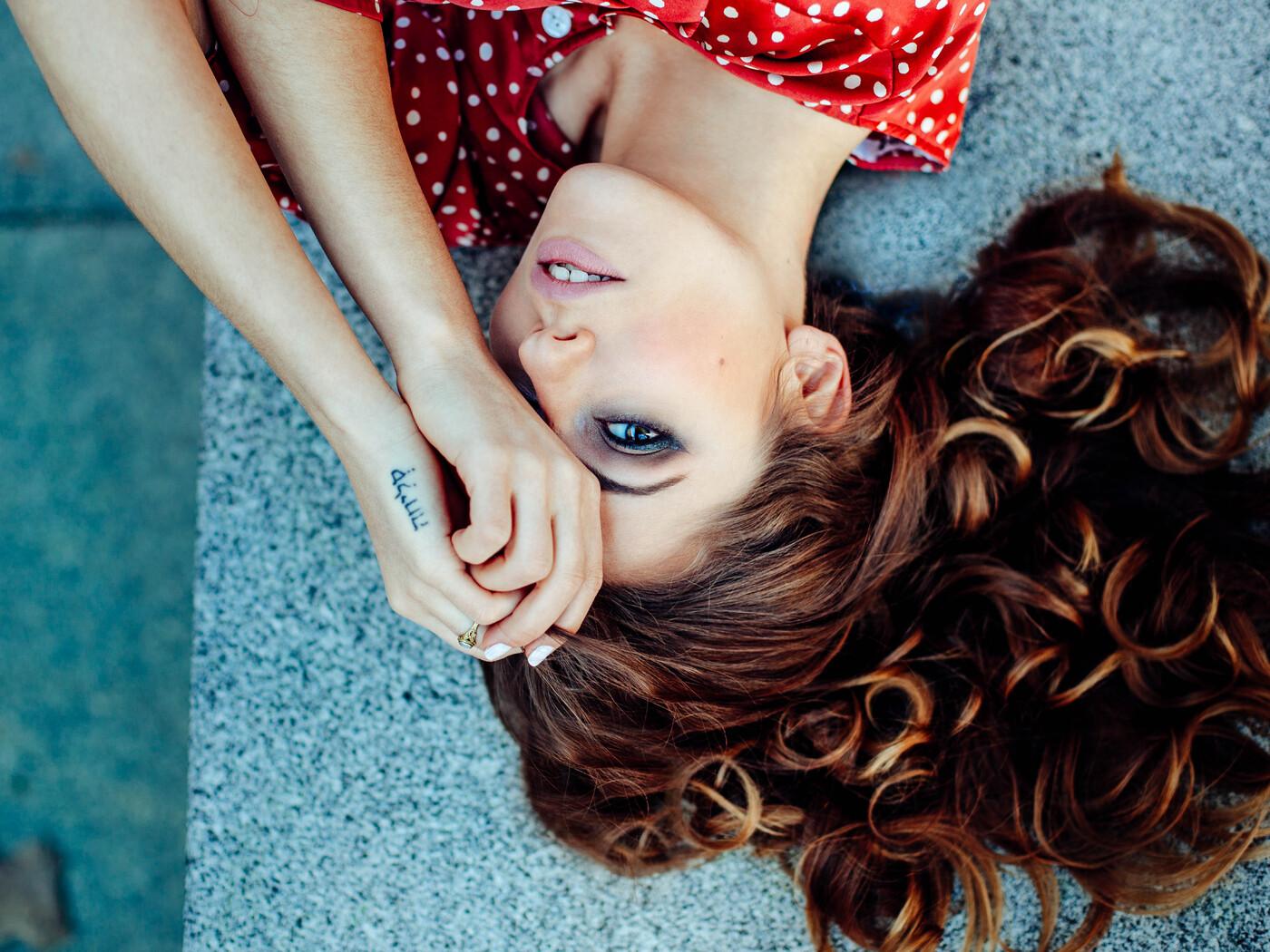 girl-lying-down-one-eye-covered-8k-x4.jpg