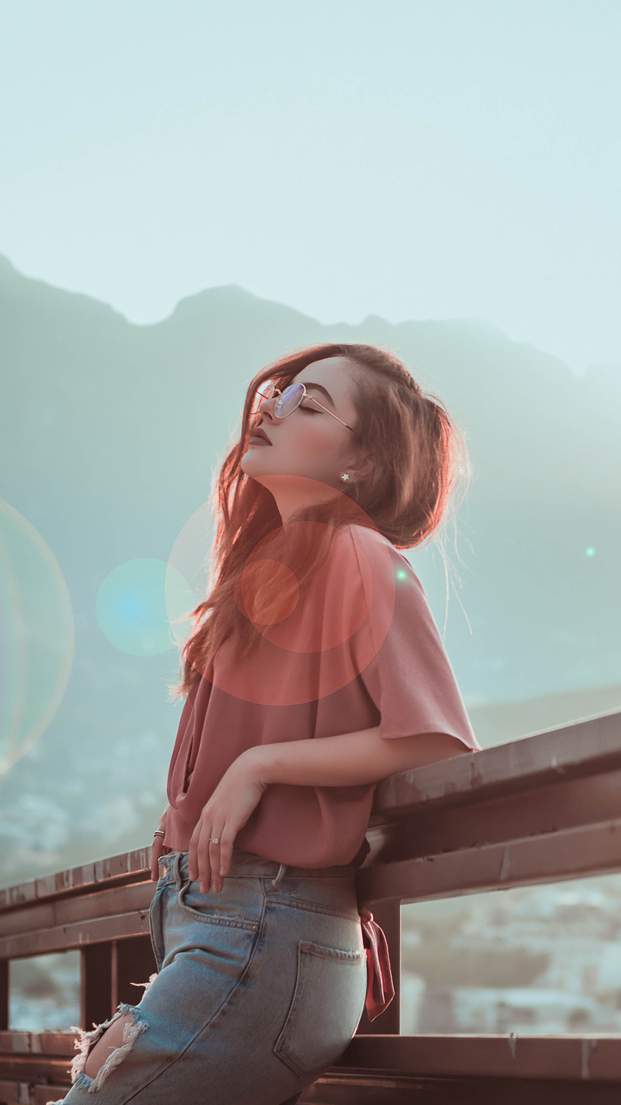 2160x3840 Women Blonde Sitting On Roof Tops 4k Sony Xperia