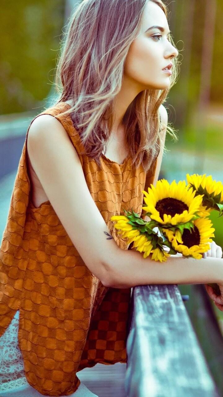 girl-standing-with-sun-flowers.jpg