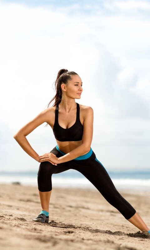 girl-streching-on-beach-qhd.jpg