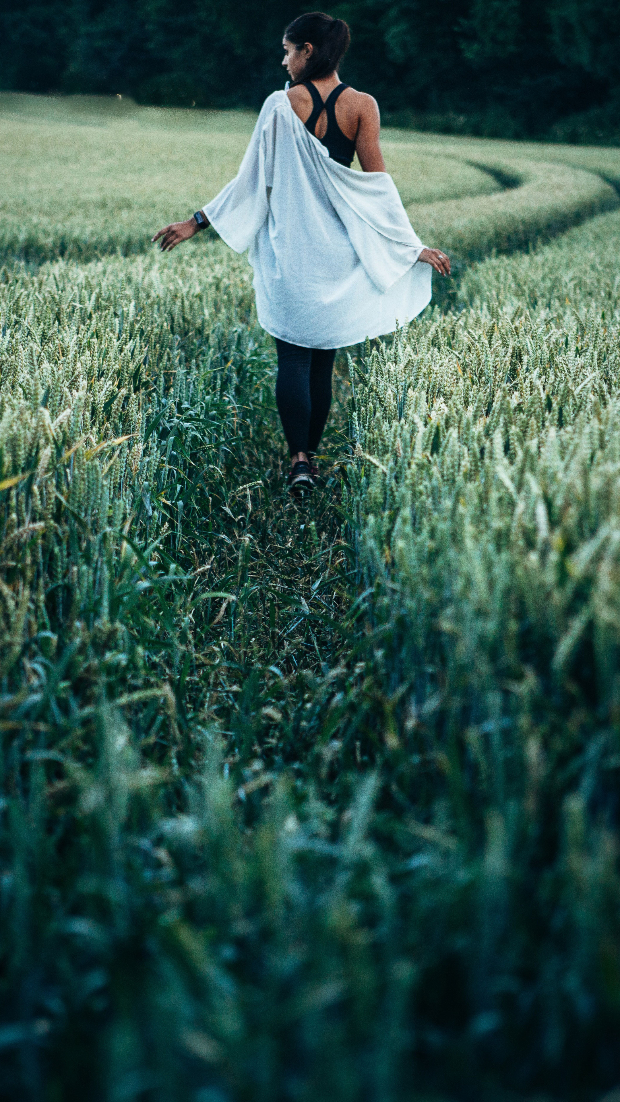 girl-walking-in-field-way-yl.jpg