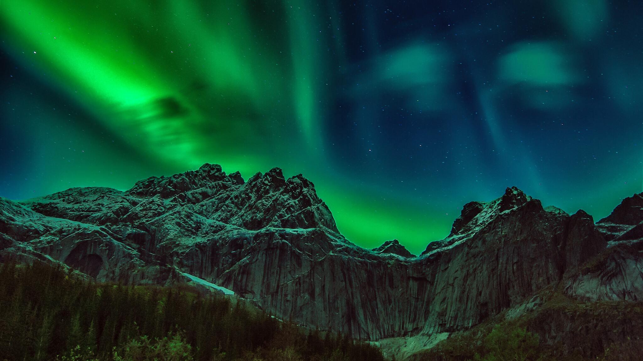green-and-brown-mountain-under-green-sky-5k-sr.jpg