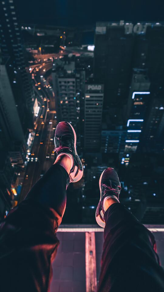 hanging-shoes-in-air-city-night-view-4k-v5.jpg