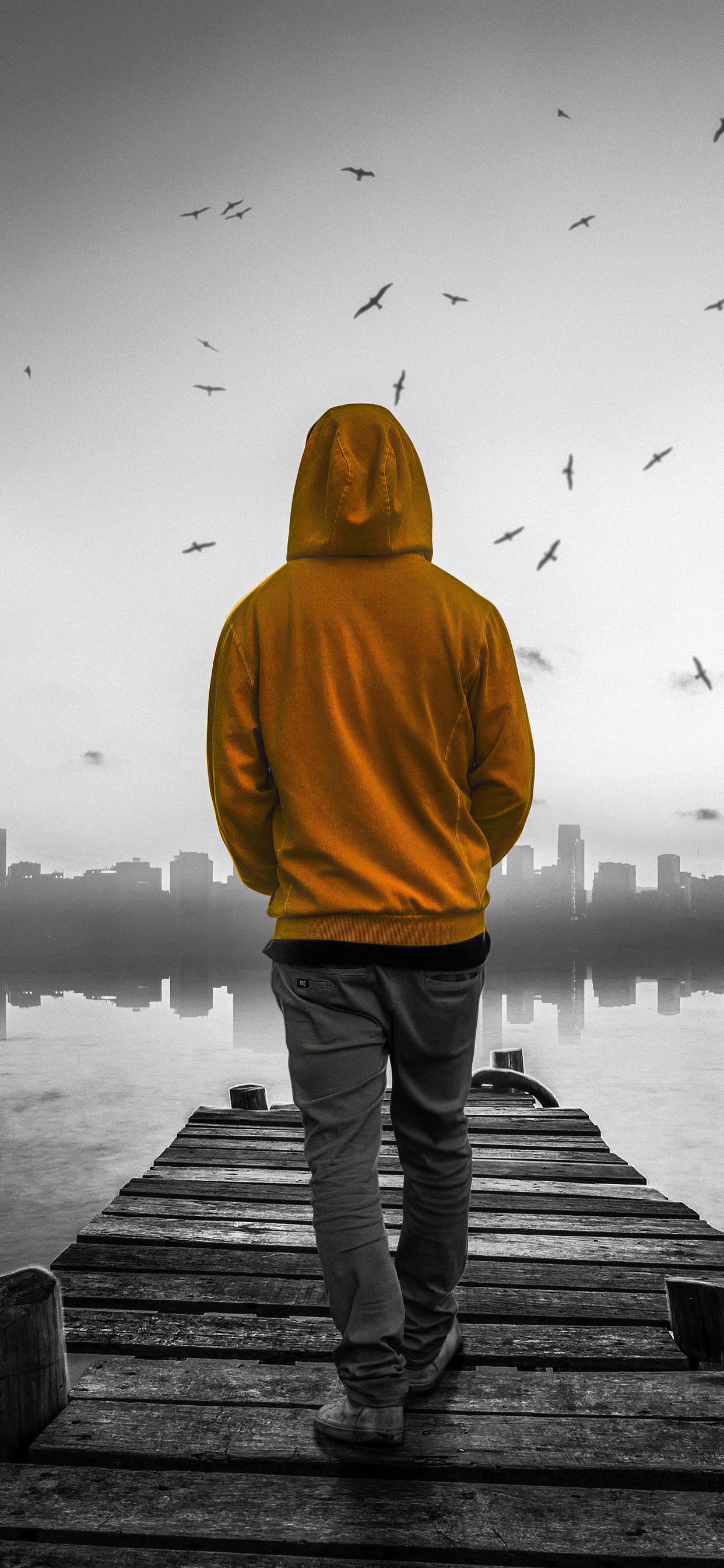hoodie-guy-walking-towards-pier-4k-76.jpg