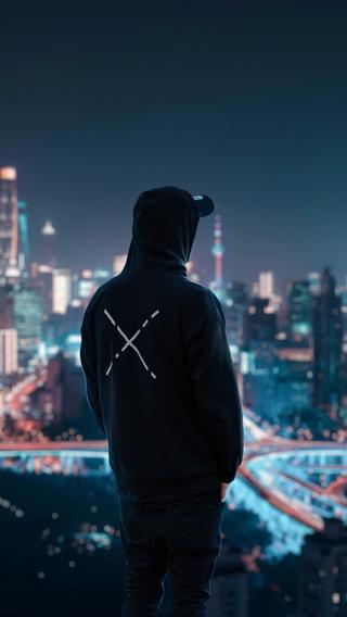 hoodie-man-looking-at-city-view-4k-lh.jpg