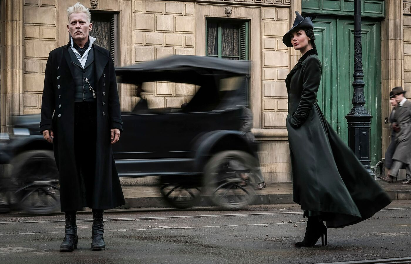 johnny-depp-and-poppy-corby-tuech-in-fantastic-beasts-2-the-crimes-of-grindelwald-2018-of.jpg