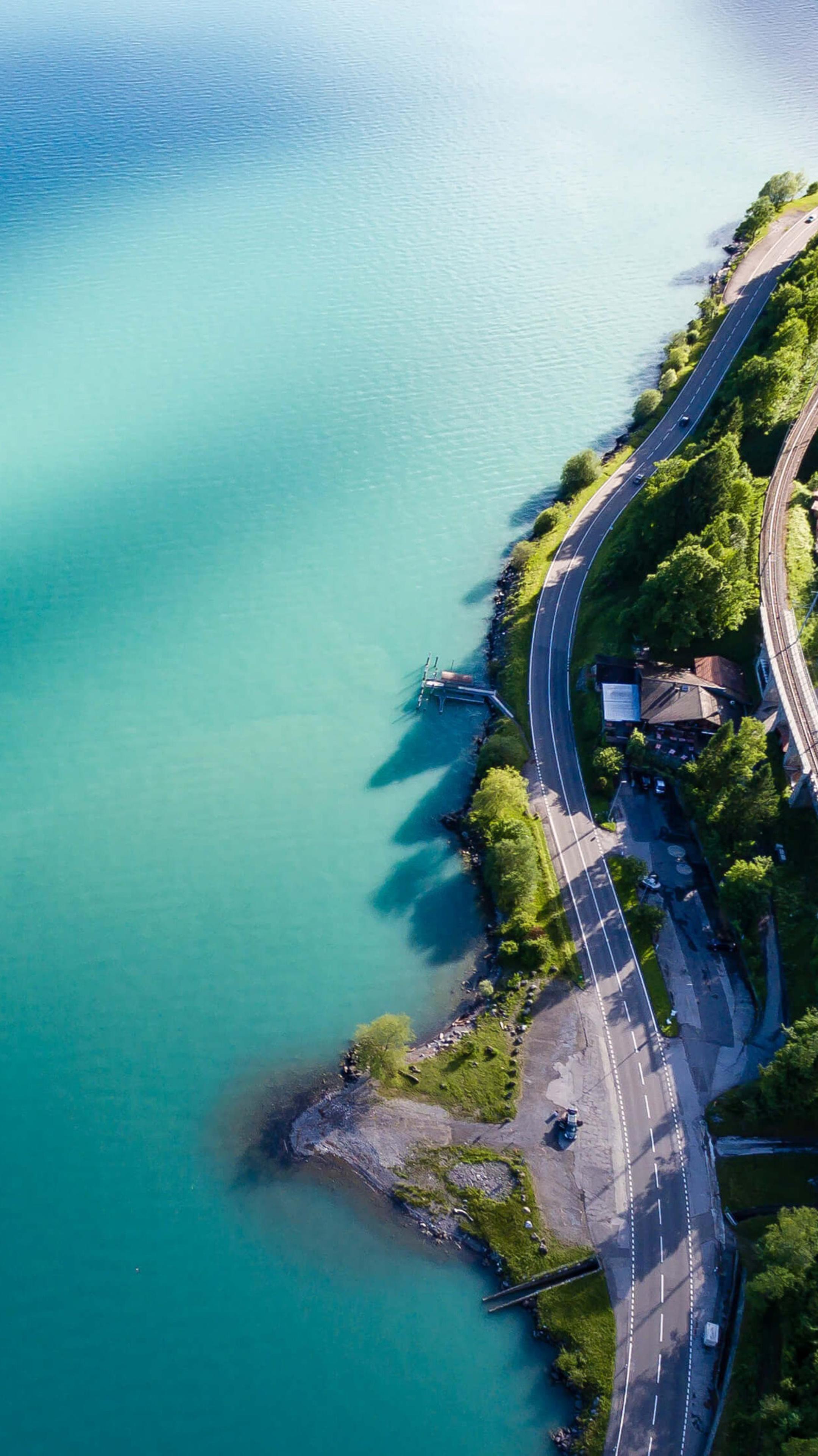landscape-road-water-trees-4k-we.jpg