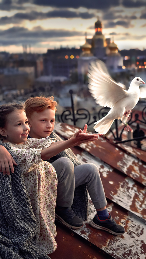 little-boy-and-girl-pigeon-roof-4k-ho.jpg