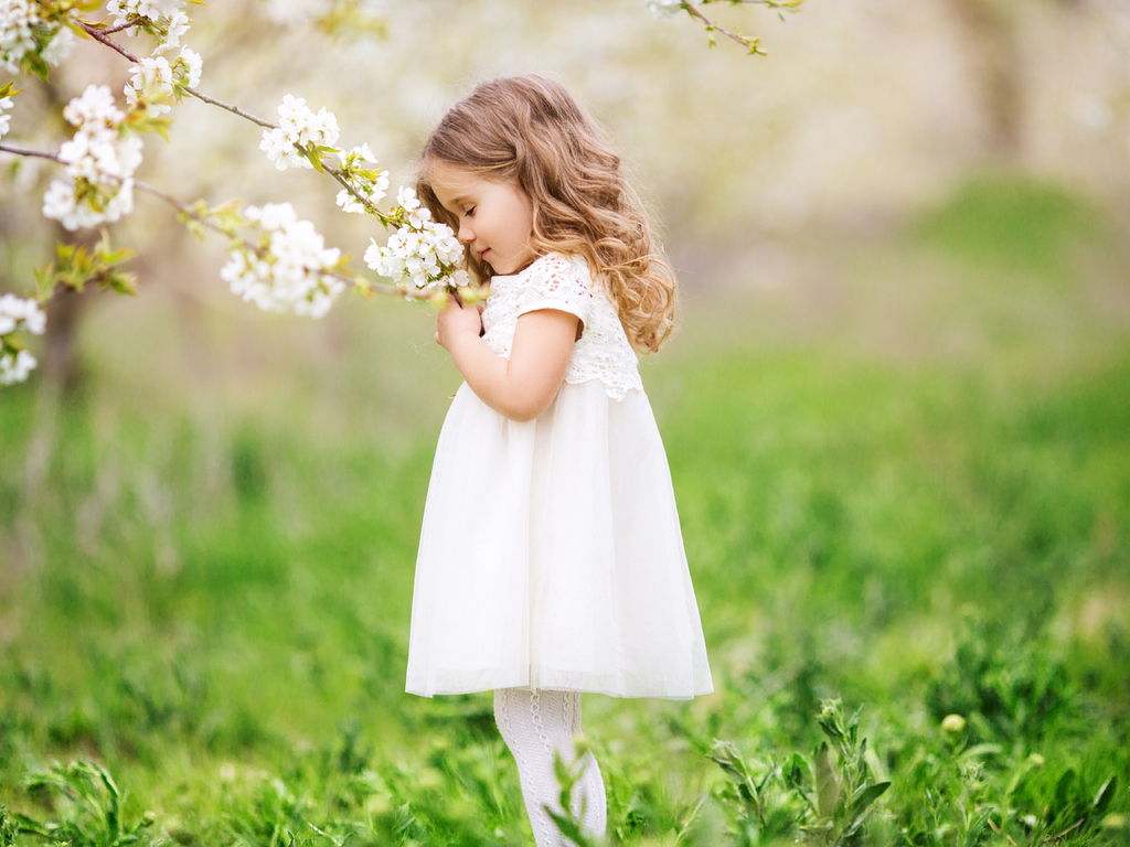 little-cute-girl-smelling-flowers-1k.jpg