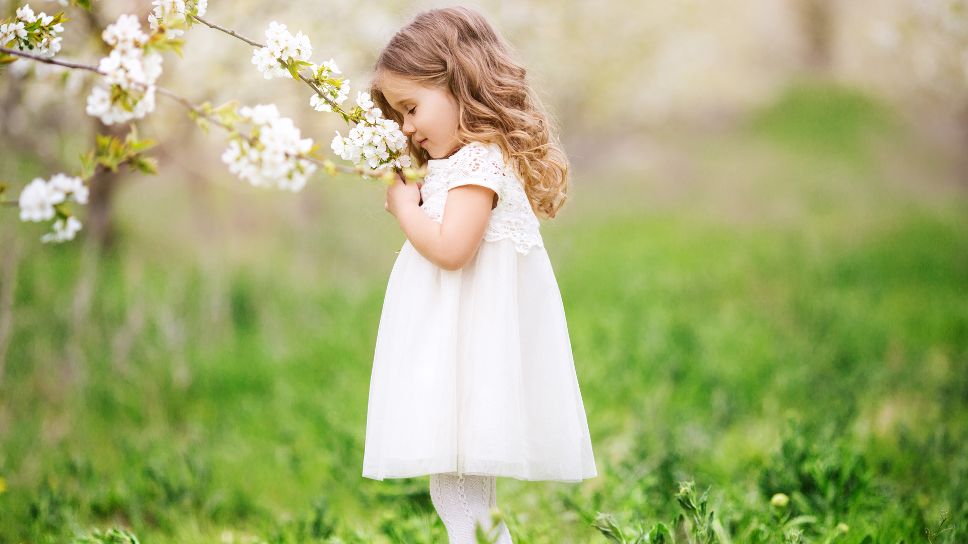1920x1080 Little Cute Girl Smelling Flowers Laptop Full HD