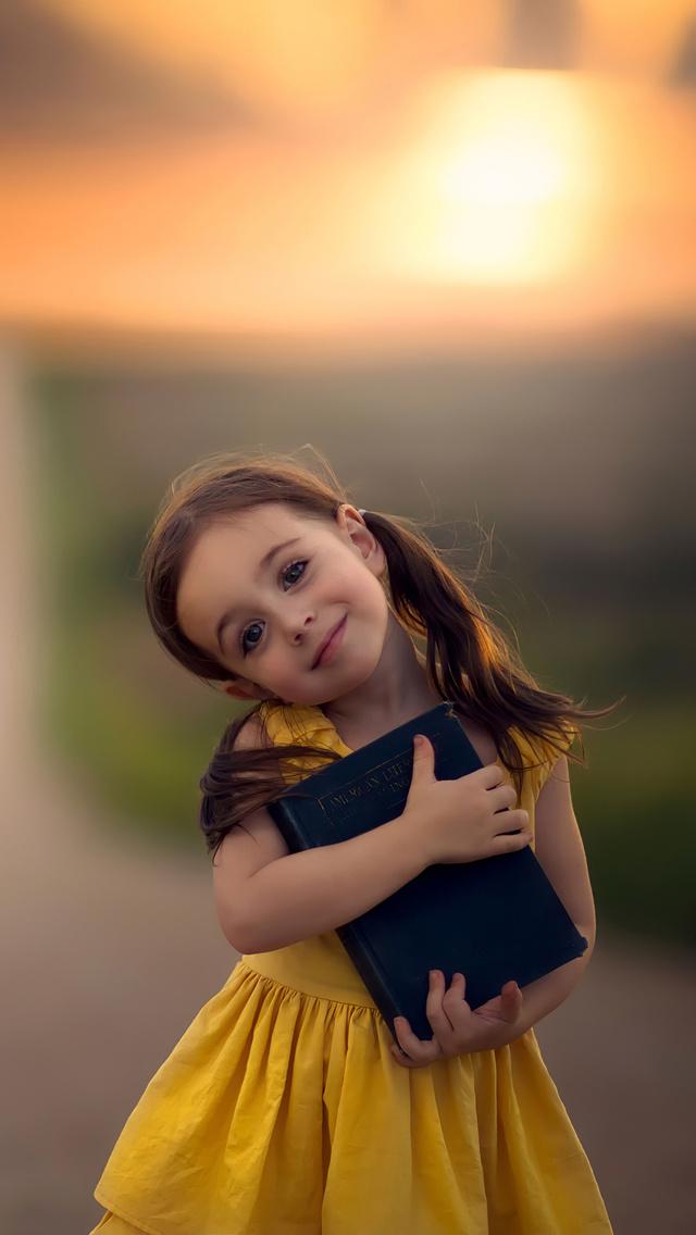little-cute-girl-with-book-ab.jpg
