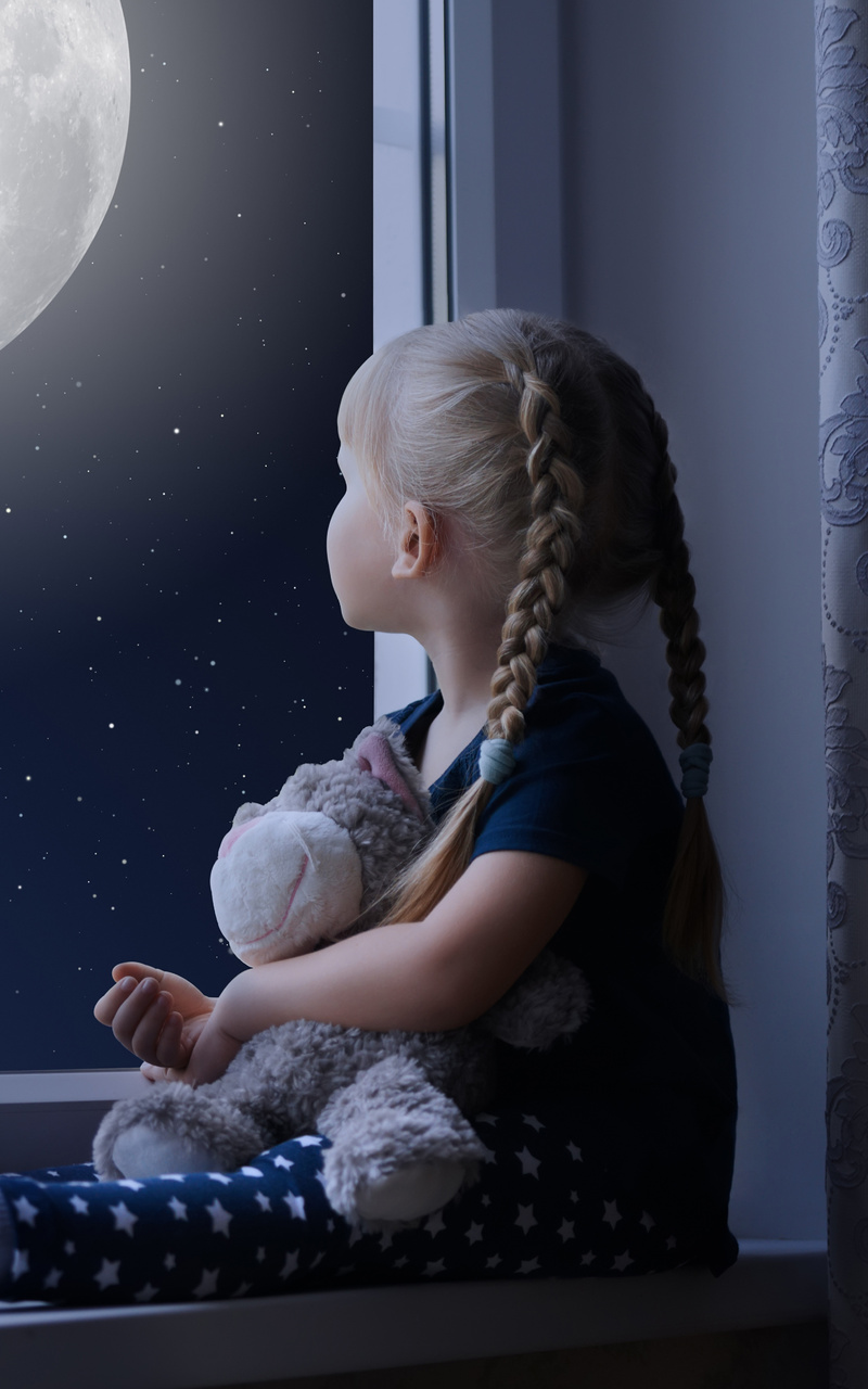 little-girl-sadly-out-of-a-window-with-a-teddy-bear-tp.jpg