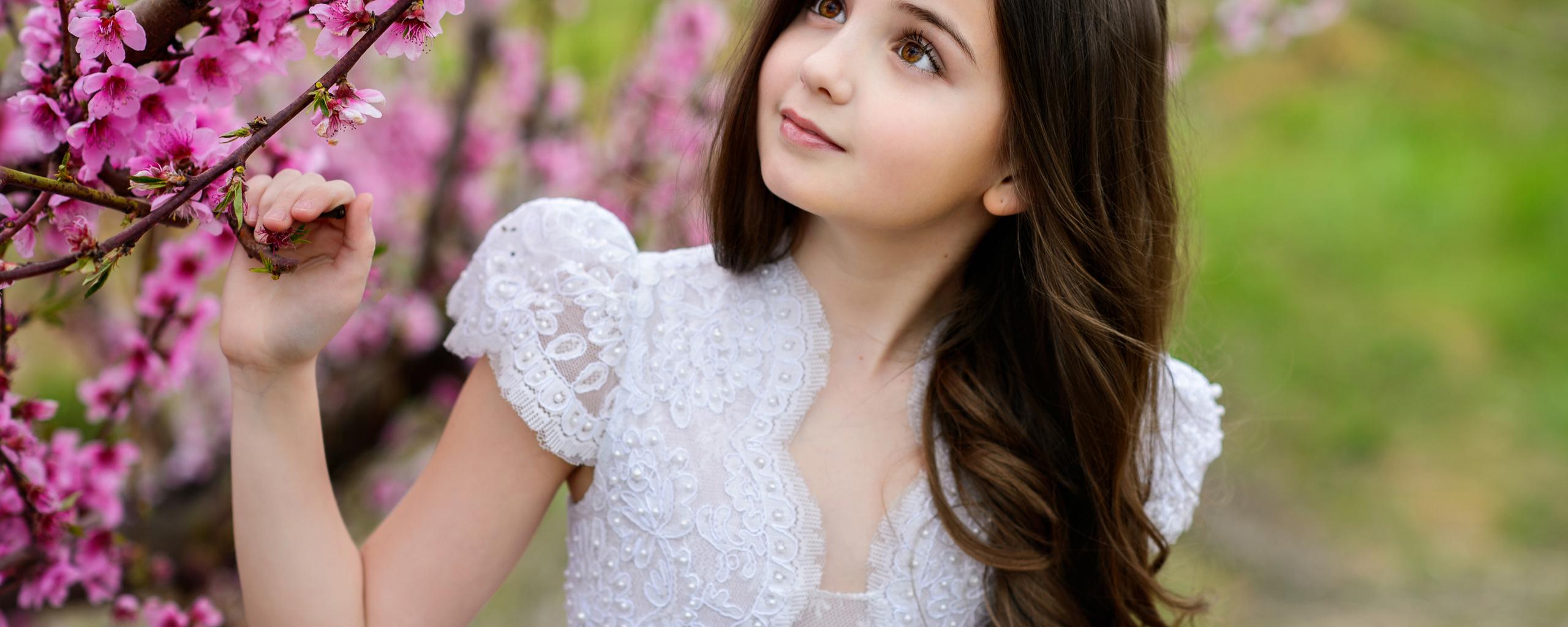 little-girl-standing-along-with-flowers-iz.jpg
