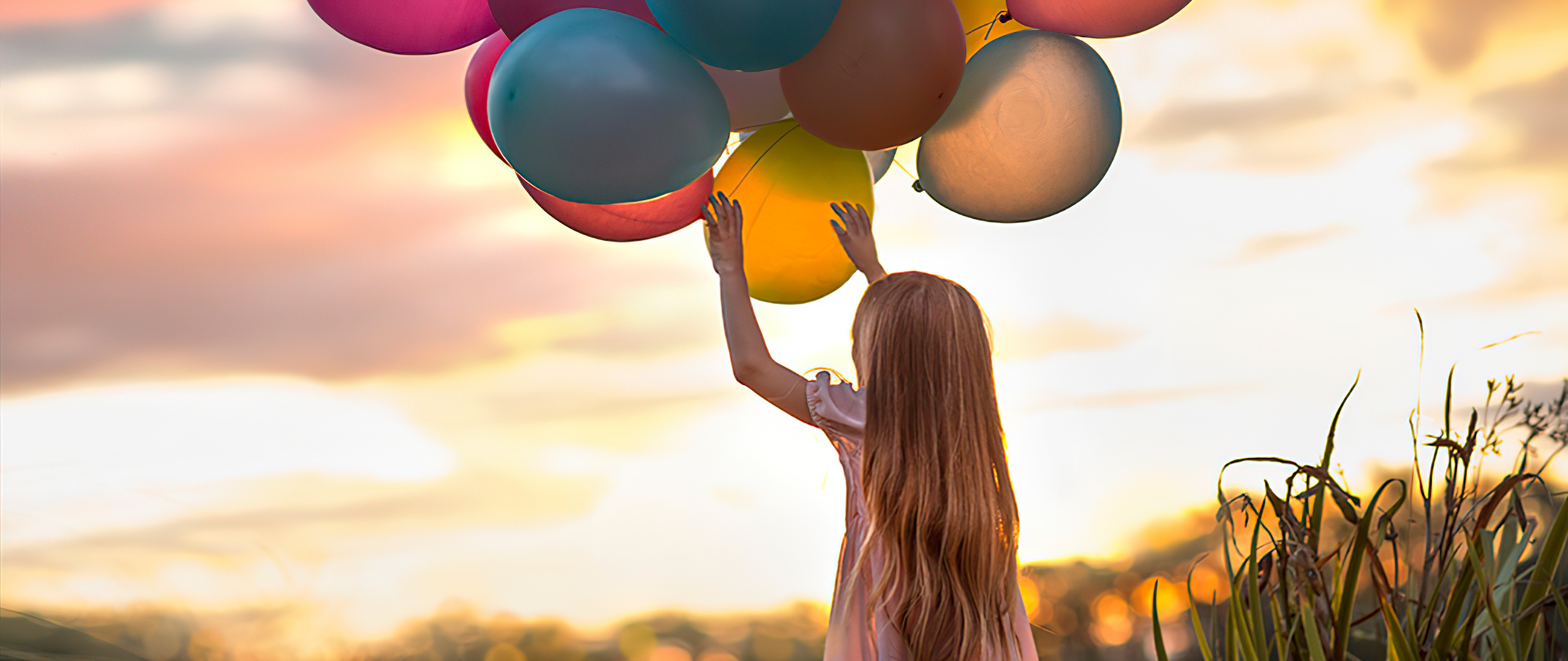 little-girl-with-colorful-balloons-tp.jpg