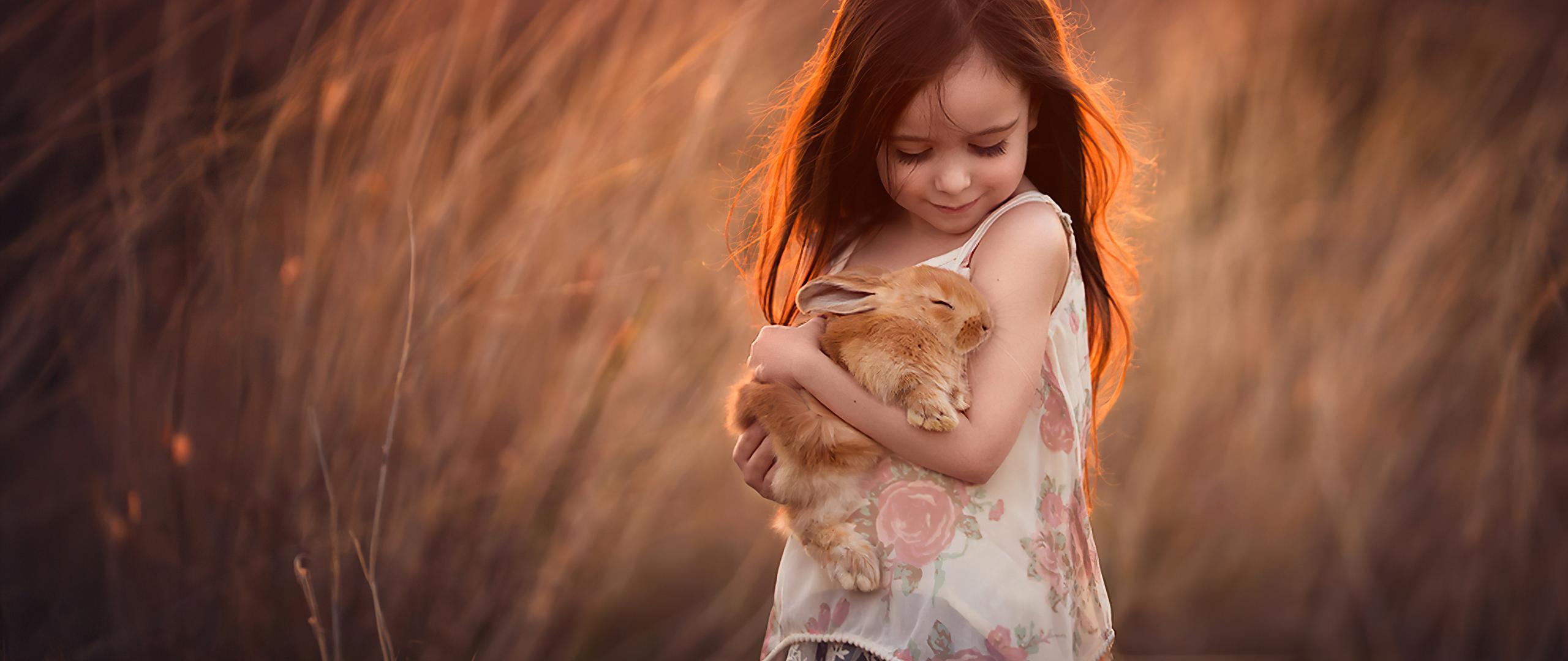 little-girl-with-rabbit-in-hands-4k-12.jpg