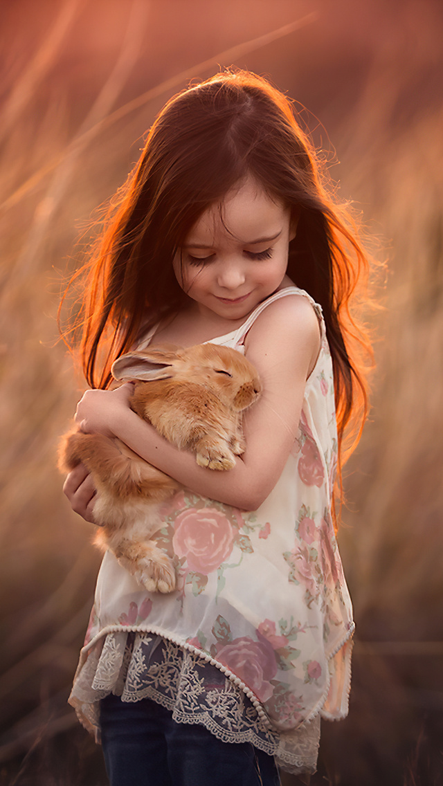 little-girl-with-rabbit-in-hands-4k-12.jpg