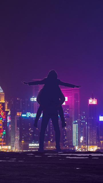 love-couple-roof-city-lights-i1.jpg