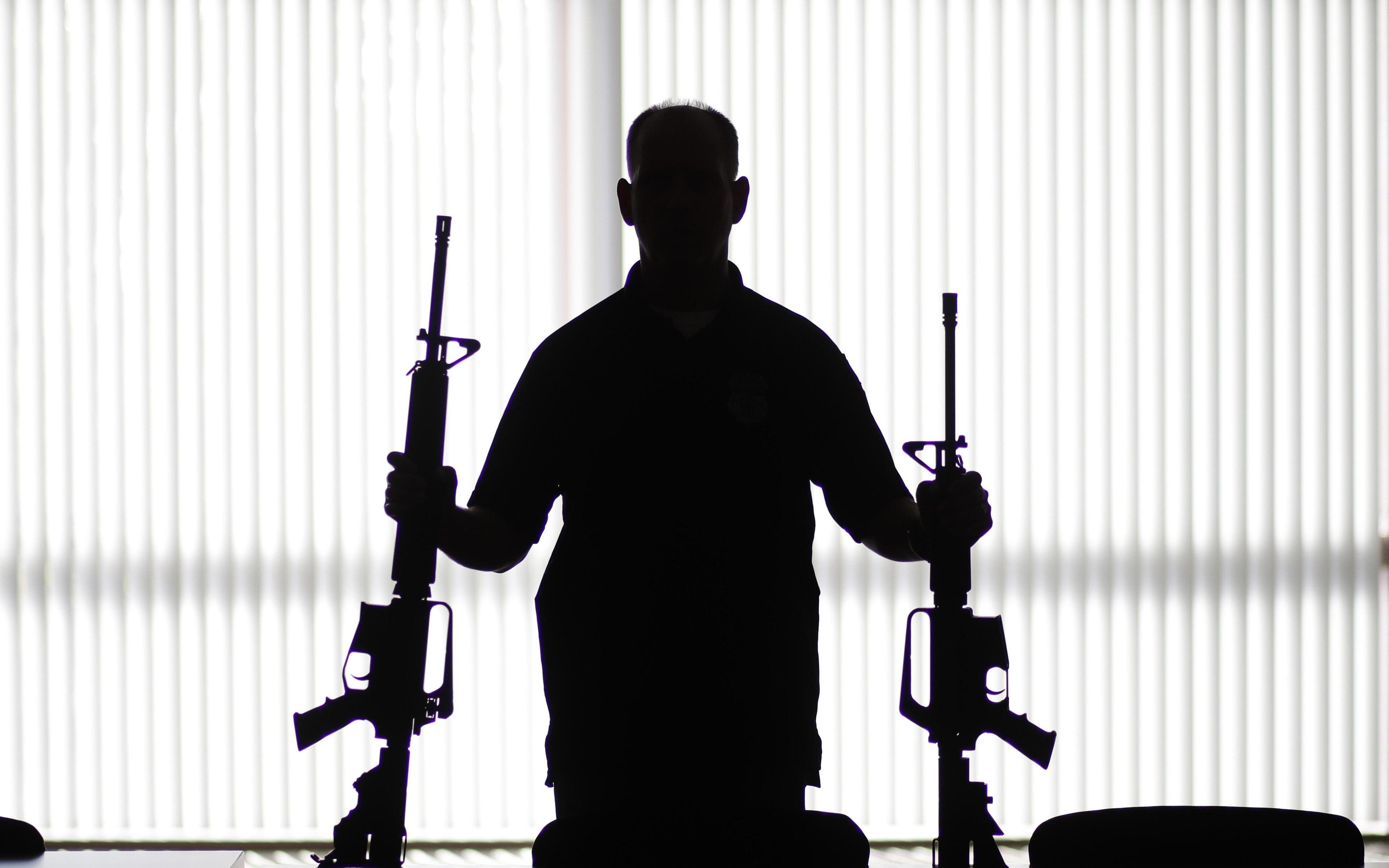 man-with-two-guns-x5.jpg